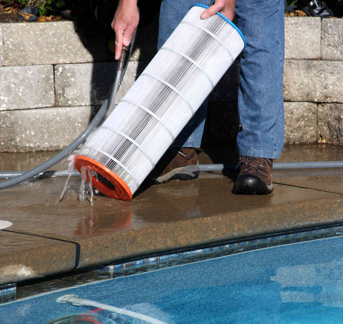 man rinsing out pool filter