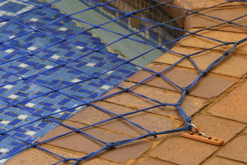 pool safety net in use on an inground pool