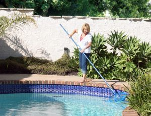 homeowner cleaning pool